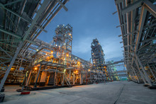 View Of Metal Pipes Of Industrial Plant Outdoor At Night