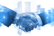 canvas print picture Partnership - business man shaking hands with effect digital network link connection graphic diagram, digital global technology with cityscape background, internet communication and teamwork concept