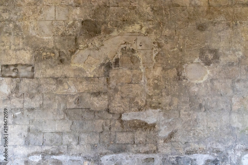 Recess Fitting Old dirty textured wall Ancient repaired limestone building wall