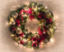 Lit Christmas Wreath On White Textured Background