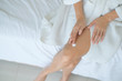 Woman applying legs cream,lotion , Hygiene skin body care concept.