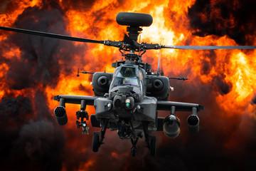 Napadački helikopter AH-64 Apache ispred velike eksplozije.