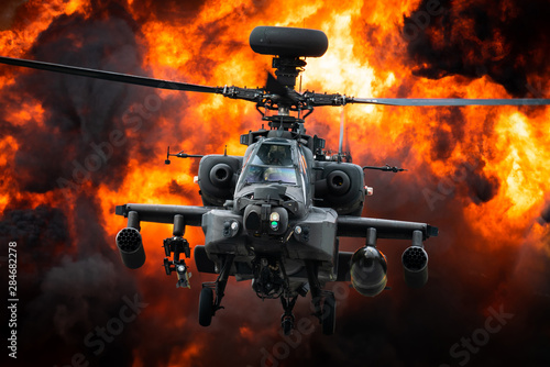 A AH-64 Apache attack helicopter in front of a large explosion. Wallpaper Mural