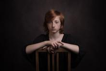 Classic Studio Portrait Of Redheaded Boy On Chair