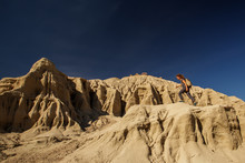 A Hiker In The Artist`s Palette Landmark Place In Death Valley National Park, Geology, Sand.