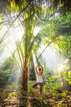 Woman Doing Yoga Outside In Jungle