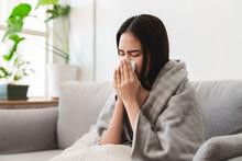 Sick Asian Young Woman Sneezin...