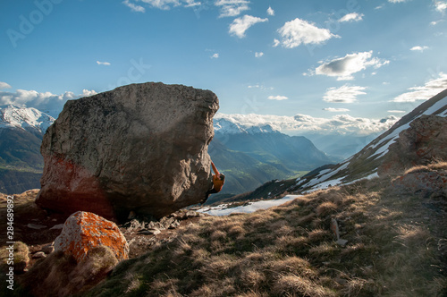 Young woman bouldering in the swiss alps Canvas Print