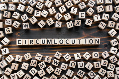 Circumlocution - word from wooden blocks with letters, an indirect way of saying Wallpaper Mural
