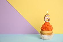 Birthday Cupcake With Number Six Candle On Color Background, Space For Text