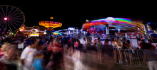 Night At The Fair With People Watching Ride Spin Around