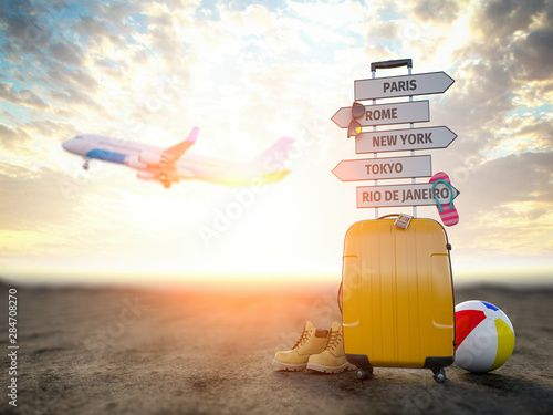 Leinwand Poster Yellow suitcase and signpost with travel destination, airplane