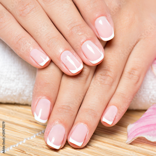 Manicure Beautiful woman's nails with french manicure