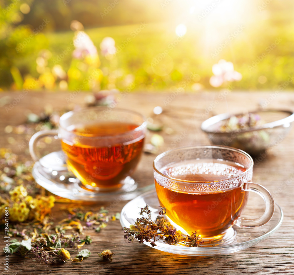 Fototapety, obrazy: Cups of herbal tea with various herbs at sunset