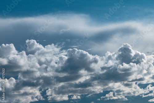 Wall Murals Heaven Dark thunderstorm and cirrus clouds in sky.