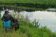 Fisherman Sitting In A Chair A...
