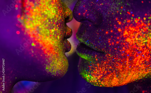 Fashion model with fluo painting on the face Canvas Print