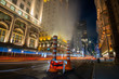 Fifth Avenue at night with light trail in New York City