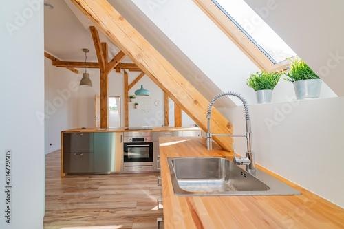 Fototapeta Modern attic white bright kitchen
