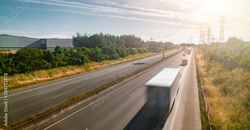 Lots of Trucks and cars on a Highway - transportation concept