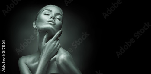 Sexy girl with holiday shiny professional makeup black and white portrait. Beaty woman touching her face closeup