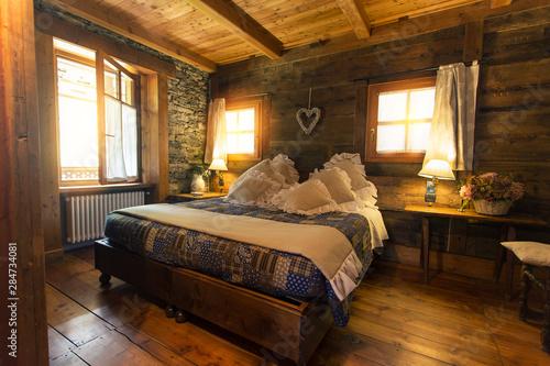 Interior shot of a mountain hut bedroom Fototapeta