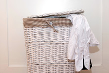 White Wicker Laundry Basket With A Man's Shirt