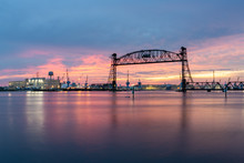 Vertical Lift Bridge For Railroad Over The Elizabeth River On The Border Of Norfolk And Chesapeake Virginia Against A Beautiful Red, Purple, Pink, And Blue Sunset