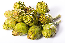 Uncooked Green Artichokes On A...
