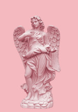 Angel Sculpture With Wings In European Church Against A Pink Background