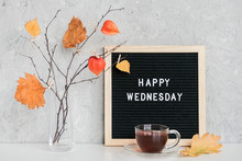 Happy Wednesday Text On Black Letter Board And Bouquet Of Branches With Yellow Leaves On Clothespins In Vase On Table Template For Postcard, Greeting Card Concept Hello Autumn Wednesday