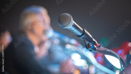 Business people talking on seminar panel with microphone Canvas Print