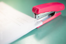 The Pink Stapler Does Not Pierce Through Many Sheets Of Paper.shallow Focus Effect.