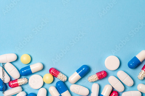 Photo Studio shot of medical pills on blue background