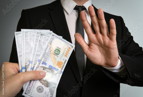 Photo Man in a suit refuses to take bribe money