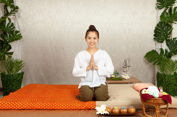 Asian thai  woman greeting with  culture Sawasdee, .welcome in thai style with traditional