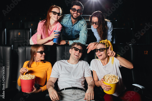 young people spending great weekend at the cinema, holiday, leisure time Slika na platnu
