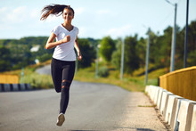 One Young Fitness Girl Runner Running Road