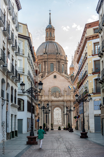 View of Alfonso I street in Zaragoza (Spain) with the cathedral of El Pilar in the background, at dawn.