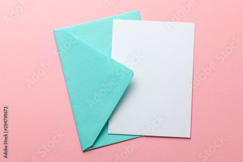 Fototapeta Green envelope and blank letter on pink background. Template with place for text on postcard. mock-up obraz