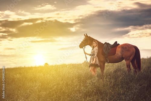 Fototapeta Beautiful girl with a horse in the field. obraz