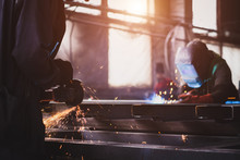 A Welder With A Welding Machine Works In A Factory