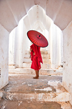 Novice Buddhist Monks With Red...