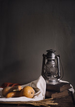 Autumn Still Life With Vintage Lantern And Pumpkin Vegetable On Rustic Wooden Table.