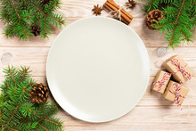 Empty White Matte Plate On Wooden Background With Christmas Decoration, Round Dish. New Year Concept