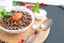Healthy Breakfast Ingredients. Healthy Tasty Breakfast Chocolate Balls With Strawberries, Raspberries, Black Currants And Red Currants.