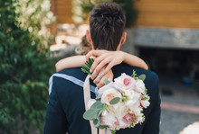 Bride's Hands And Wedding Bouq...