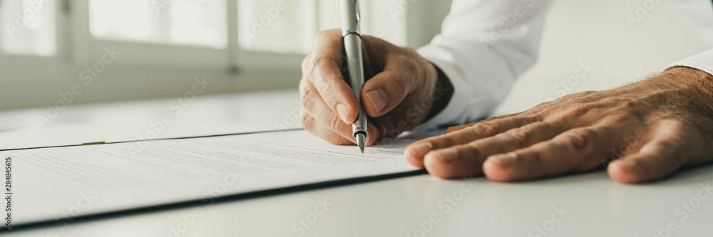 Fototapeta Signing a document or contract