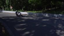 Women Driving Motorbike On Road In Forest