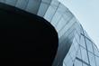 Leinwanddruck Bild - Modern architecture business building abstract curve line details steel facade background .
